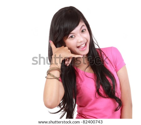Closeup portrait of beautiful young woman making call me gesture on white background - stock photo