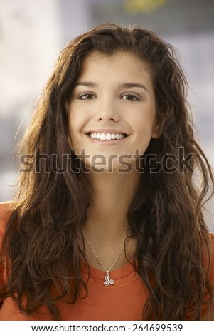 Closeup portrait of beautiful young woman smiling happy at camera. - stock photo