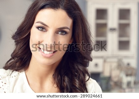 Closeup portrait of beautiful young woman smiling happy, looking at camera. - stock photo