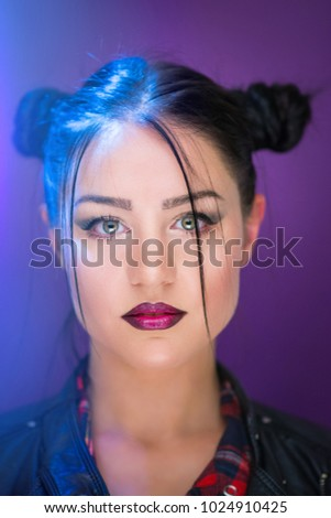 Closeup portrait of beautiful young woman with green eyes and dark lipstick