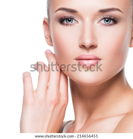 Closeup portrait of beautiful young woman with hand near face - isolated on white background. - stock photo