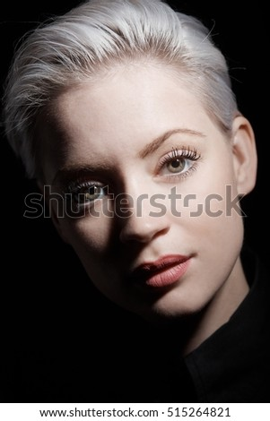 Closeup portrait of beautiful young woman with short hair.