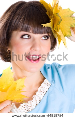 closeup portrait of beautiful young woman with yellow leaves on white background