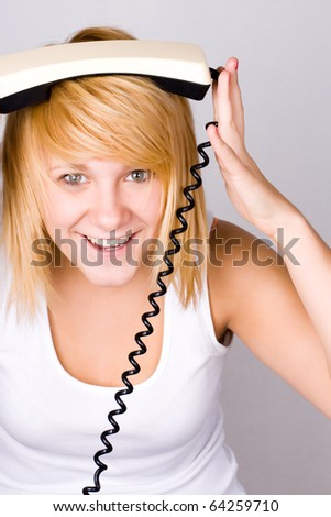 closeup portrait of blond woman with retro telephone - stock photo