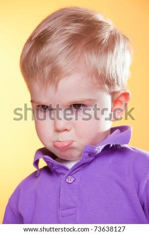 Closeup portrait of blonde little upset boy pout - stock photo