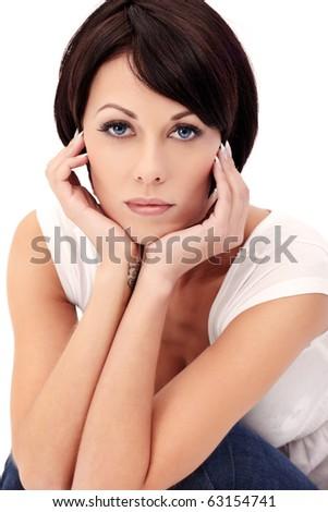 Closeup portrait of brunette female model with blue eyes on white background - stock photo