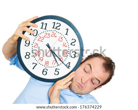 Closeup portrait of business man funny looking student holding clock stressed running out pressured by lack of time guy overwhelmed boy, late for meeting isolated on white background. Negative emotion - stock photo