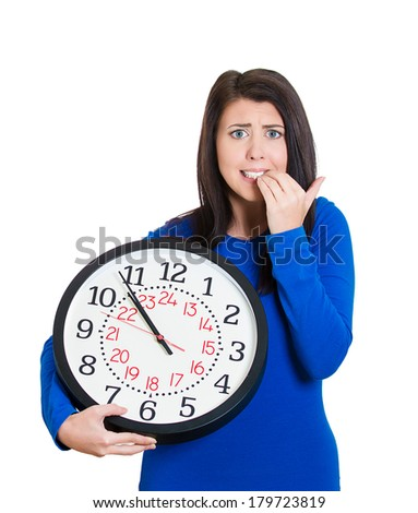 Closeup portrait of business woman, student, worker employee holding clock, looking anxious at you, pressured by lack of time, running out of time isolated on white background. Negative human emotion - stock photo