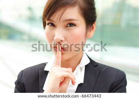 Closeup portrait of business woman with a secret
