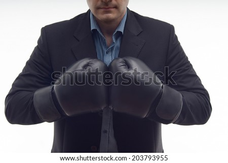Closeup portrait of businessman in black boxing gloves isolated on white background - stock photo