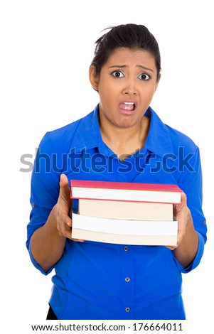 Closeup portrait of busy nervous worried young woman carrying tons of books, stressed from project deadline, isolated on white background. Negative emotion facial expression feelings, body language - stock photo