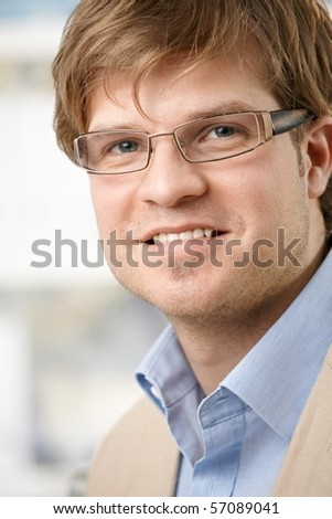 Closeup portrait of casual young businessman with glasses, smiling.? - stock photo