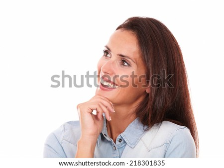 Closeup portrait of charming adult woman on blue blouse looking and smiling to her right on isolated white background - copyspace - stock photo