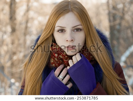 closeup portrait of charming beautiful girl in winter outdoor - stock photo