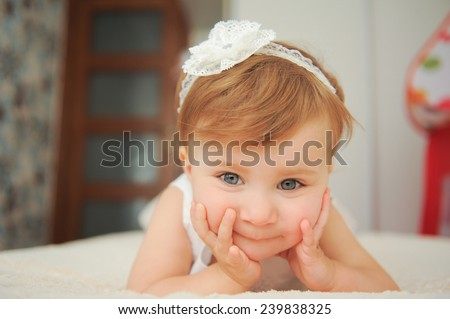 closeup portrait of charming girl lying in bed - stock photo