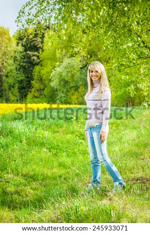 closeup portrait of charming, lovely woman standing, smiling, on green background - stock photo