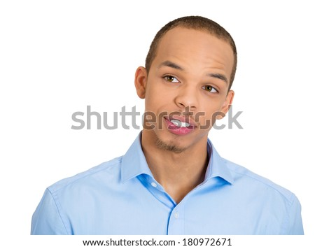 Closeup portrait of charming upbeat smiling joyful happy young man looking upwards and to side, daydreaming, isolated on white background. Positive emotion facial expression feelings, attitude  - stock photo
