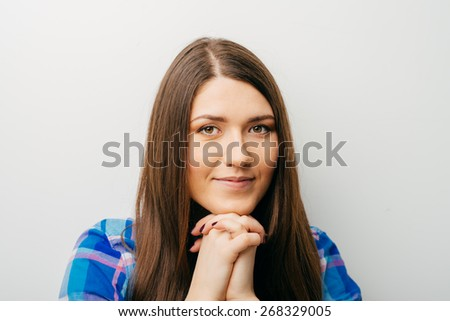 Closeup portrait of charming upbeat smiling joyful happy young woman looking upwards with hand on chin daydreaming, isolated on white background. Positive human emotions facial expressions feelings - stock photo