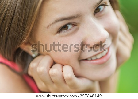 Closeup portrait of charming young female smiling. - stock photo