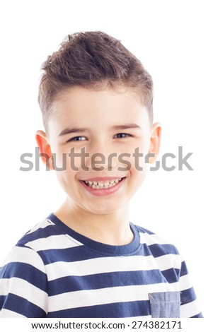 Closeup portrait of cheerful boy, smiling and looking at camera - stock photo