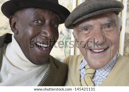 Closeup portrait of cheerful multiethnic senior men smiling - stock photo