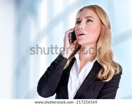 Closeup portrait of cheerful smiling businesswoman talking on phone, making deal, professional communication, business and success concept  - stock photo