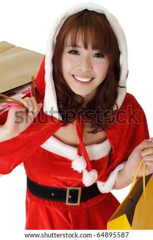 Closeup portrait of Christmas girl holding bags and shopping. - stock photo