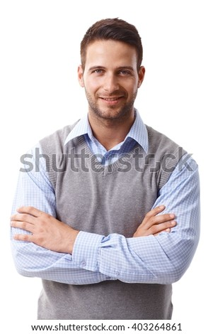 Closeup portrait of confident young businessman standing arms crossed, smiling, looking at camera. - stock photo