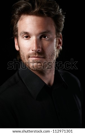 Closeup portrait of confident young man looking at camera. - stock photo