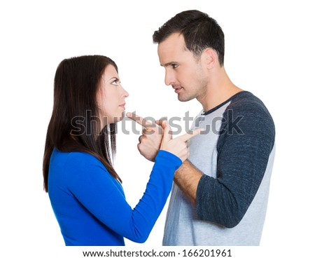 Closeup portrait of couple, man, woman, pointing fingers and blaming each other for the problem, isolated on white background. Marriage difficulties concept. Negative emotions, expressions, feelings - stock photo