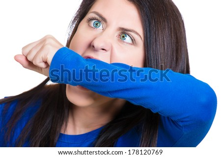 Closeup portrait of crazy, angry, looney young business woman, student, worker employee going through stress, conflict in life biting her arm, isolated on white background. Negative human emotions. - stock photo