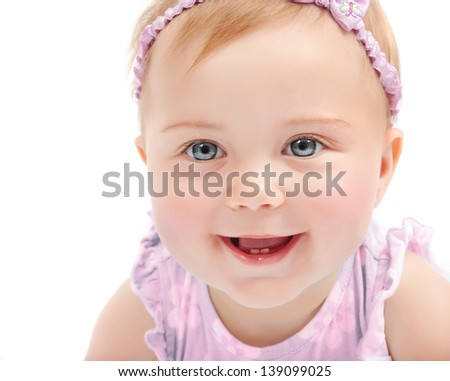 Closeup portrait of cute baby girl isolated on white background, adorable child having fun in studio, happiness concept - stock photo