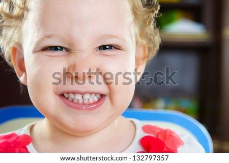 Closeup portrait of cute curly haired girl