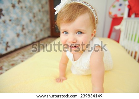 closeup portrait of cute girl on bed - stock photo