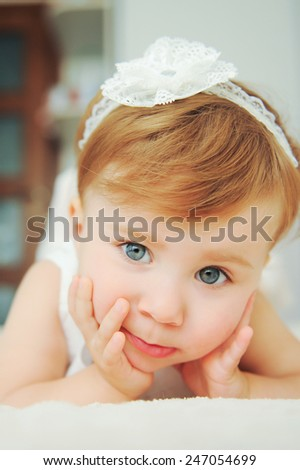 closeup portrait of cute girl with lace bow - stock photo