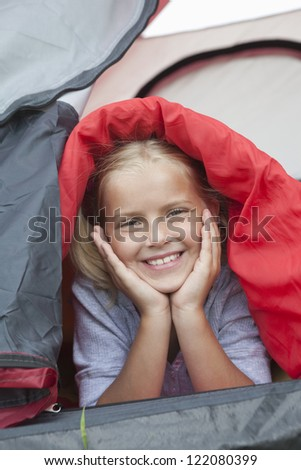 Closeup portrait of cute little Caucasian girl in tent