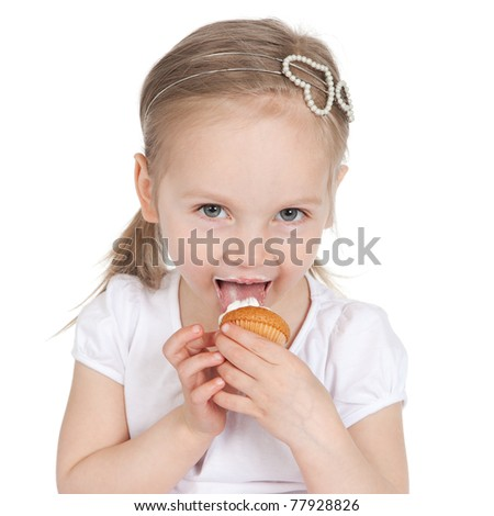 Closeup portrait of cute little girl with cake on her face - stock photo