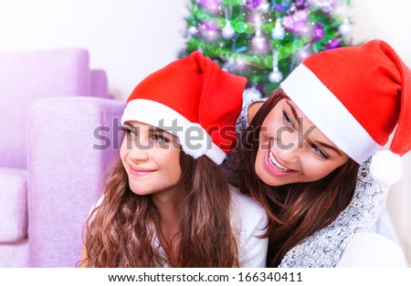 Closeup portrait of cute mother with cheerful daughter celebrate Christmas holiday at home, happy family party, winter vacation concept - stock photo