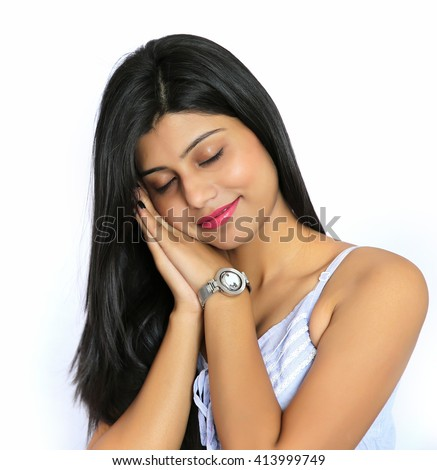 Closeup portrait of cute pretty smiling young indian woman sleeping, isolated on white background. - stock photo