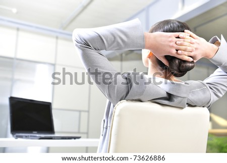 Closeup portrait of cute young business woman from behind - stock photo