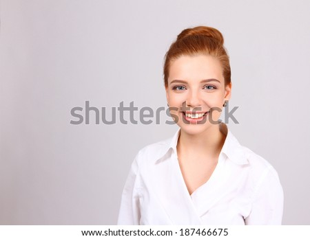 Closeup portrait of cute young business woman smiling isolated