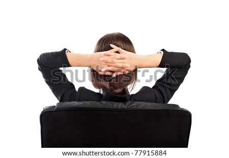 Closeup portrait of cute young relaxed business woman from behind with open hands behind her head - stock photo