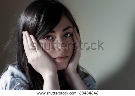 Closeup portrait of depressed teenager girl. - stock photo
