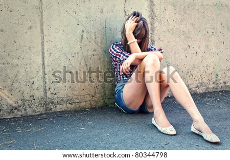 Closeup portrait of depressed teenager girl.