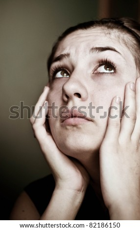 Closeup portrait of depressed teenager girl. - stock photo