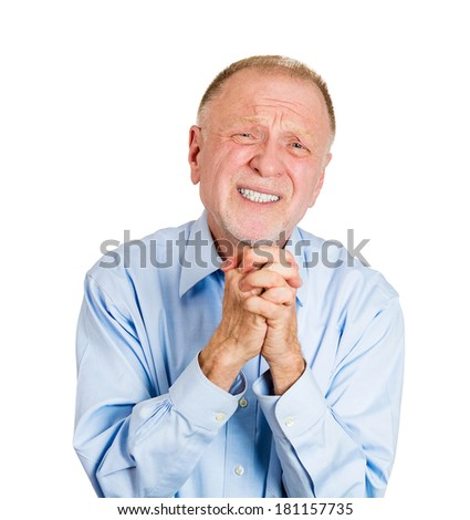 Closeup portrait of desperate, senior mature man showing clasped hands, pretty please with sugar on top, isolated on white background. Positive emotion facial expression feelings, body language. - stock photo