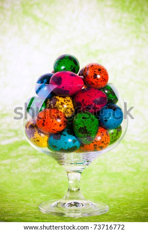 Closeup portrait of Easter colorful eggs in glass - stock photo