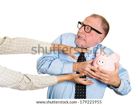 Closeup portrait of elderly, shocked senior business man, grandfather, holding piggy bank, looking scared, trying to protect his savings from being stolen isolated on white background. Financial fraud - stock photo