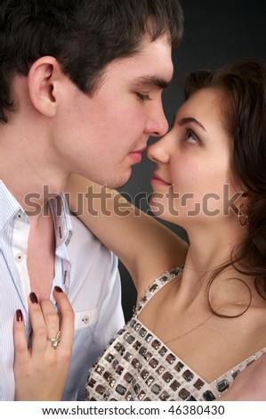 Closeup portrait of embracing beautiful sexual couple - stock photo