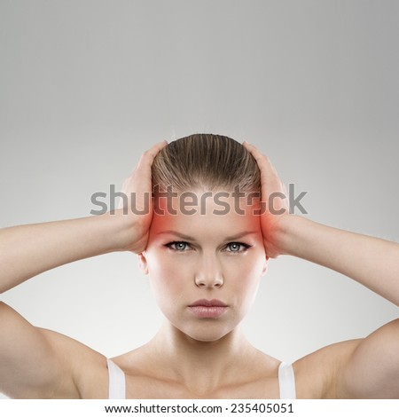 Closeup portrait of exhausted woman with vertigo or headache problem. Young attractive Caucasian female suffering from chronic migraine.  - stock photo